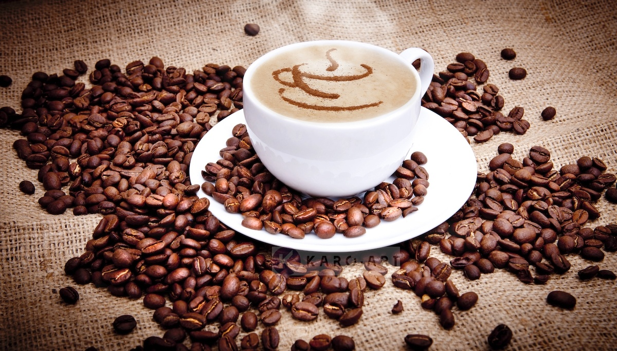 Schilderij - Kopje koffie en bonen , Bruin wit , 2 maten , Wanddecoratie -  1 luik - 100x70 cm