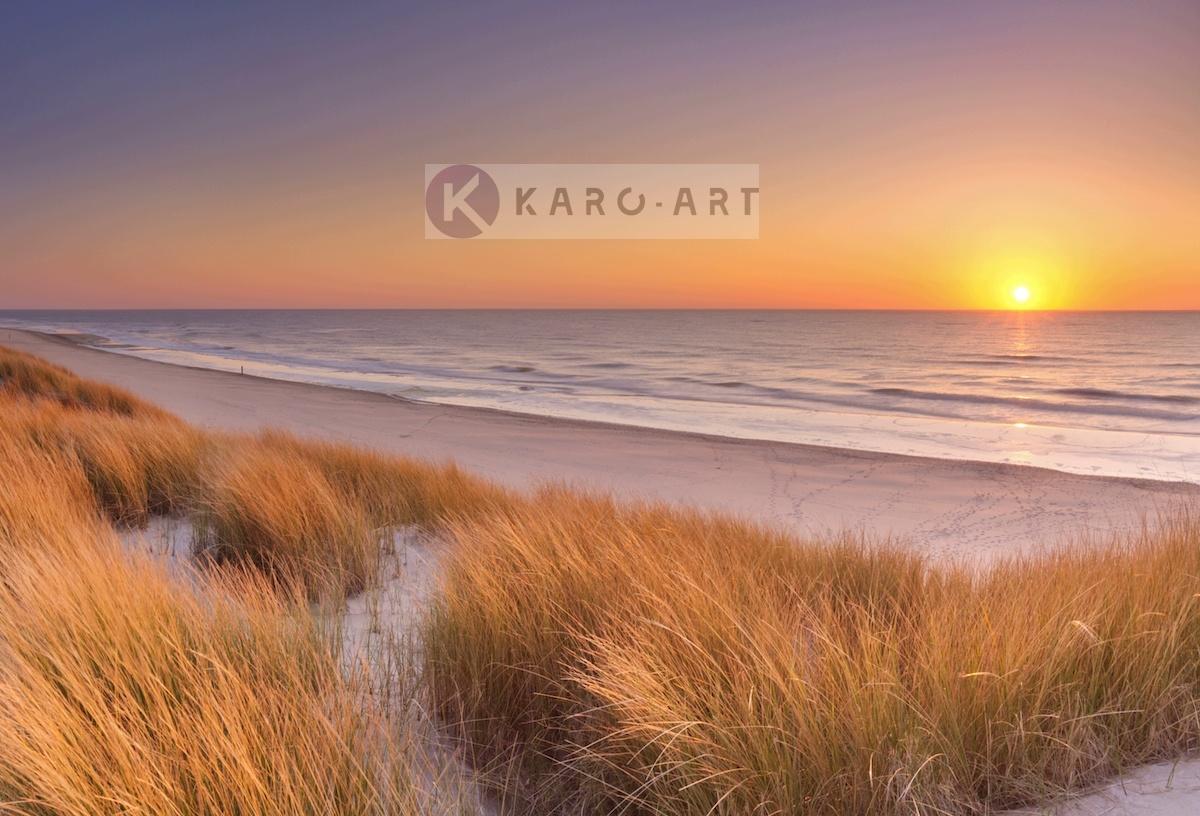 Afbeelding op acrylglas - Duinen en strand bij zonsondergang op Texel