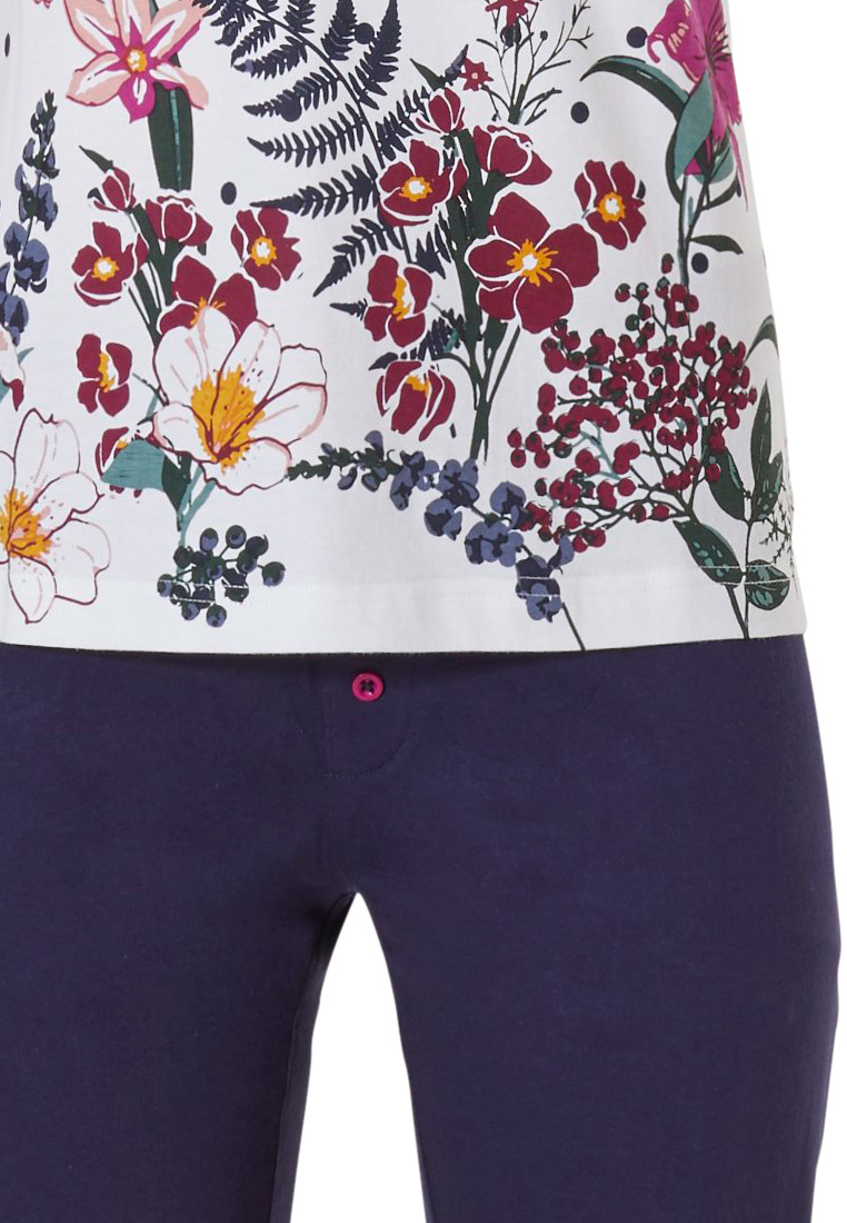 Pastunette 'dots & pretty garden flowers' pure white & dark blue dots, short-turned-up sleeve, ladies cotton pyjama set with 3 buttons, 'pretty garden flowers' around the the bottom and 3/4 dark blue pants with fuschia pink button detailing