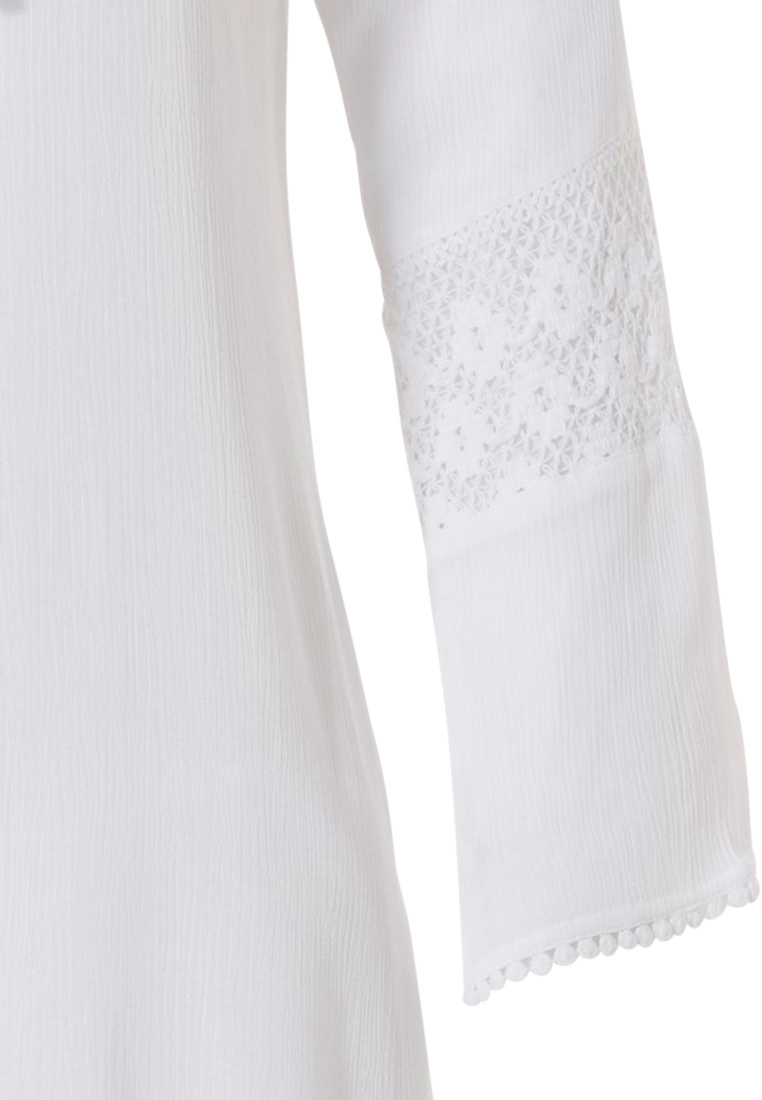Pastunette Beach Pastunette Beach pure white long sleeve tunic style holiday cover-up with tassle front tie with loop hole back, pretty embroidered sleeves with bobble detail trim - Perfect for Summer!