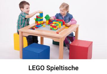 Kinder bauen an einem Lego Tisch