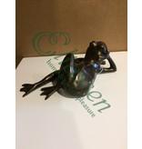 Bronze frog lying