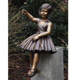Bronze girl with flower
