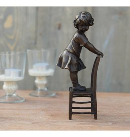 Eliassen Image bronze girl standing on chair