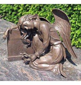 Eliassen Grave statue angel against gravestone bronze