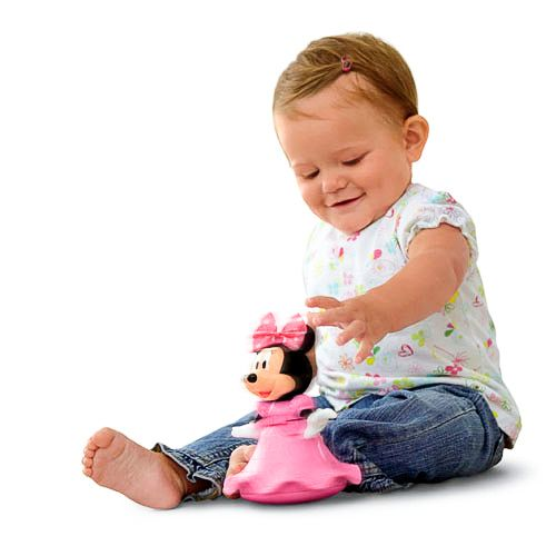 Leuke baby Minnie Mouse draaiend en twirling speelgoed