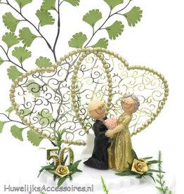Komische taarttopper met gouden jubileum bruidspaar