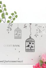Gastenboek met daarop 2 zilver vogelkooien