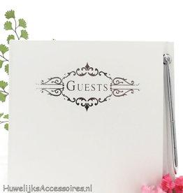 Gebroken witte gastenboek met pen