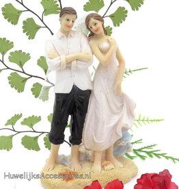 Huwelijk op het strand bruidspaar taarttopper