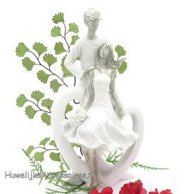 Wit en zilver bruidspaar op een hart taarttopper