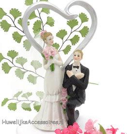 Bruidspaar taarttopper met een zilveren hartje