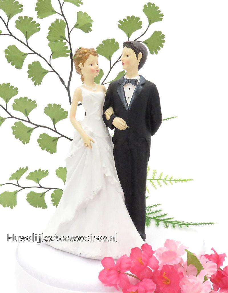 Elegante bruidspaar voor op de bruidstaart