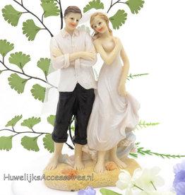 Bruidspaar trouwen op het strand taarttopper
