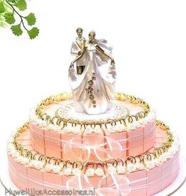 Bruiloft bedankjes taart goud ringen en roosjes