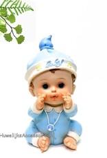 Zittende blauwe baby in pyjama taarttopper