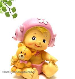 Roze meisje taarttopper met een knuffel