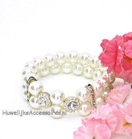 Elastische armband met parels en strass bloemen