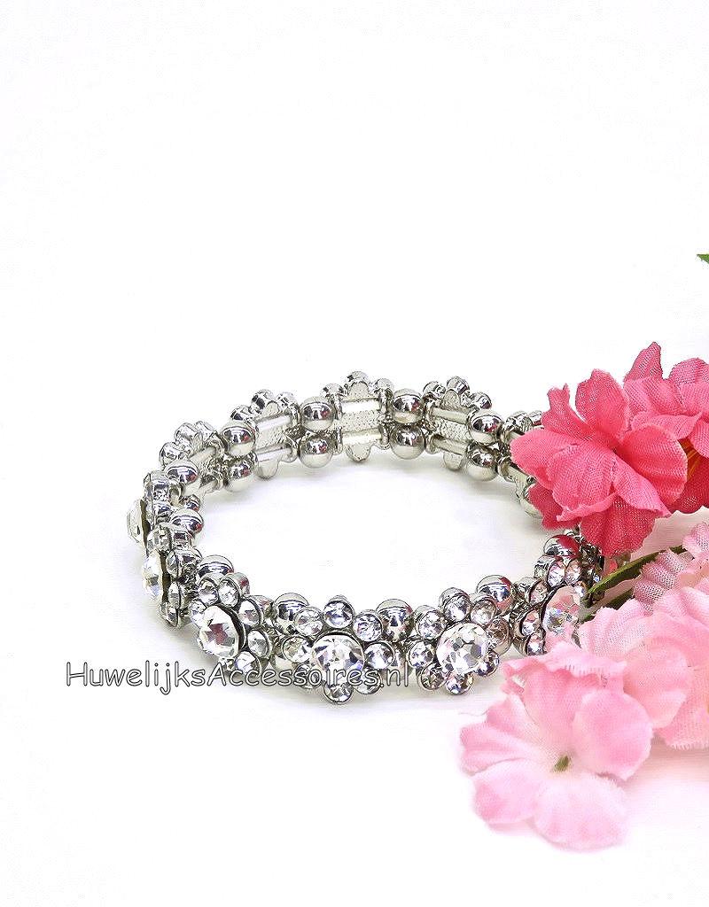 Elastische armband met strass stenen bloemen en zilver ballen