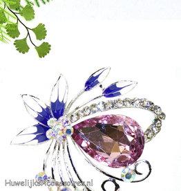 Broche met een grote lila strass steen