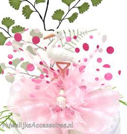 Schattige roze ooievaar taart topper