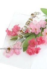 Zilver armband met amber en zilver kralen