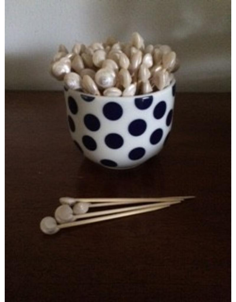 Cocktail sticks with a shell