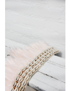 Feather decoration on a tripod