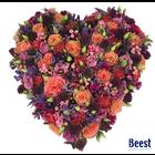 Rouwstuk hart  groot gemengde bloemen