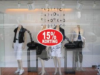 """Ovale """"15% korting"""" Sticker auf Niederländisch"""