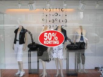 """Ovale """"50% korting"""" Sticker auf Niederländisch"""