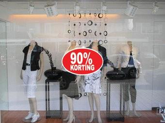 """Ovale """"90% korting"""" Sticker auf Niederländisch"""