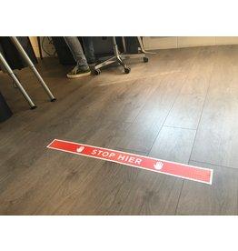 Pare aquí etiqueta de piso Corona