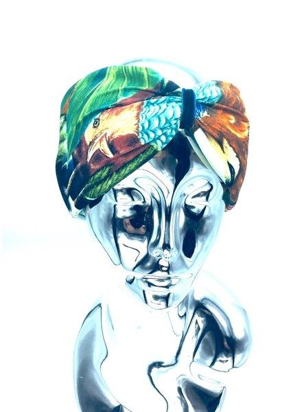"Embrace Kopfband ""Exotic"" in Schleifenoptik drapiert mit blauen Samtband"