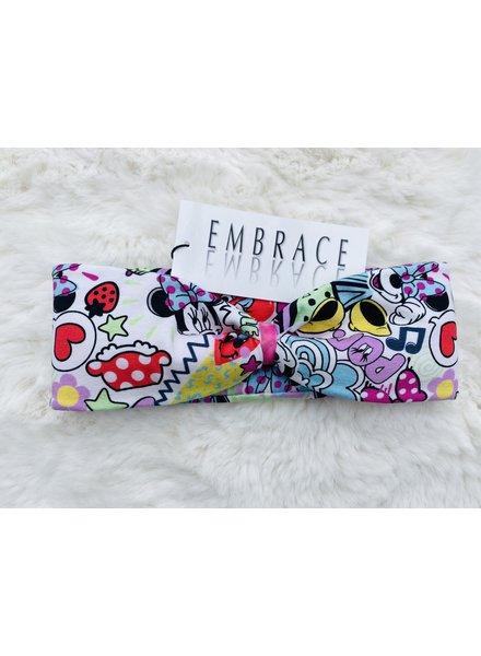 "Embrace Kopfband ""comic pop up"" in Schleifenoptik drapiert mit rosafarbenen Samtband"