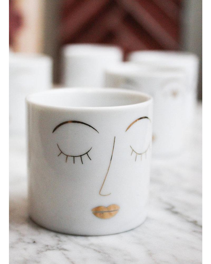 Rader Teelichtkerze mit Gesicht
