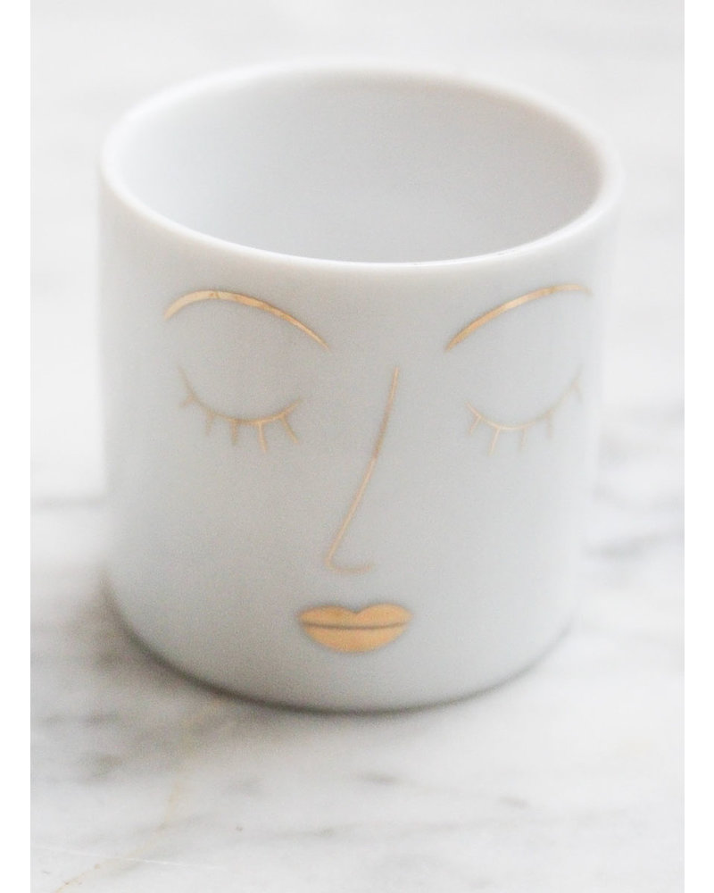Rader Tealight candle with face