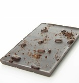 A bar of dark chocolate with roasted coffee beans