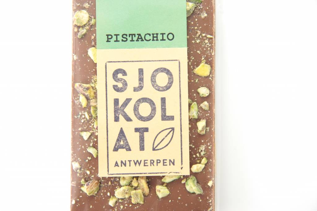 A bar of milk chocolate with pistachio nuts