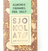 A bar of milk chocolate with almonds, caramel and seasalt