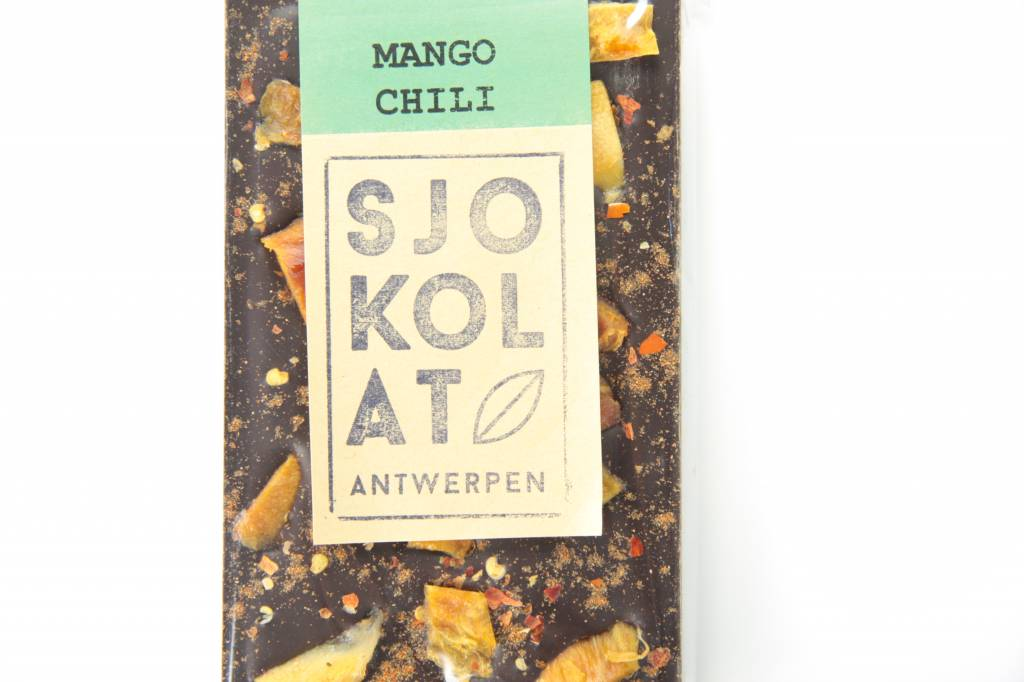A bar of dark chocolate with mango and chili pepper