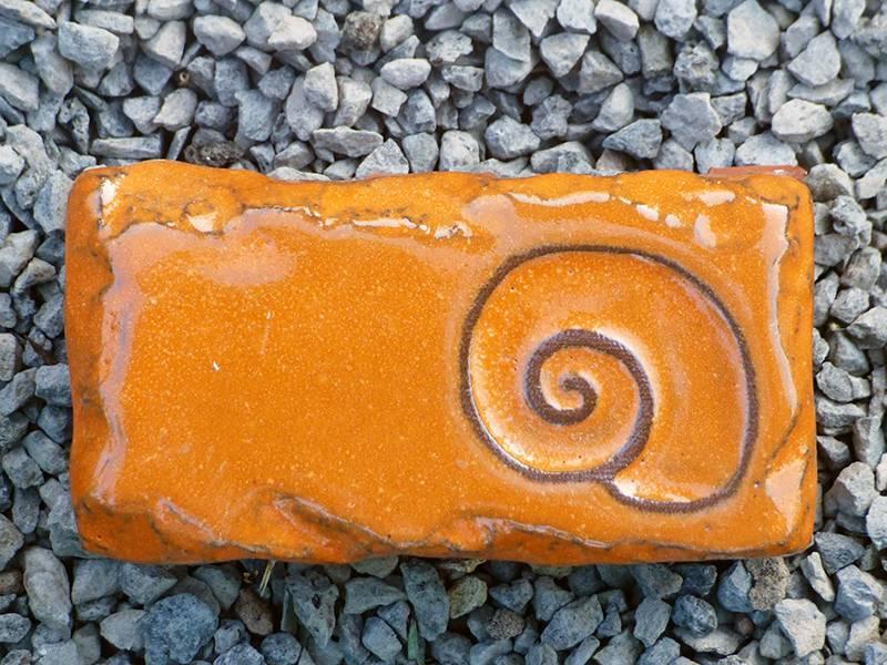 Motiv Pflasterstein Schnecke, lang, orange, absolut frostfest