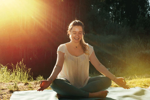 Yoga en meditatie zijn een goede strategie voor meer positiviteit en geluk.