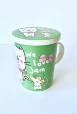 Green tea cup with cat and mouse