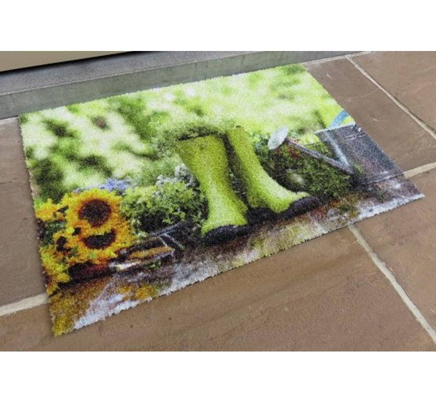 Schrapende deurmat foto groene kaplaarzen