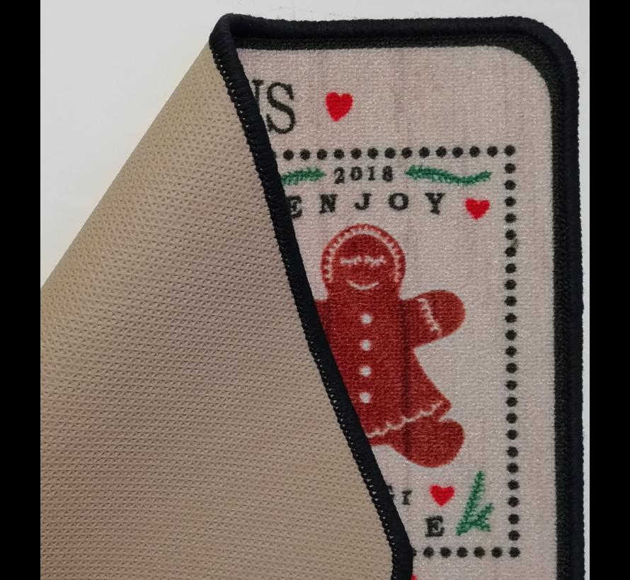 Tapis de Noël imprimé avec des figures de pain d'épice