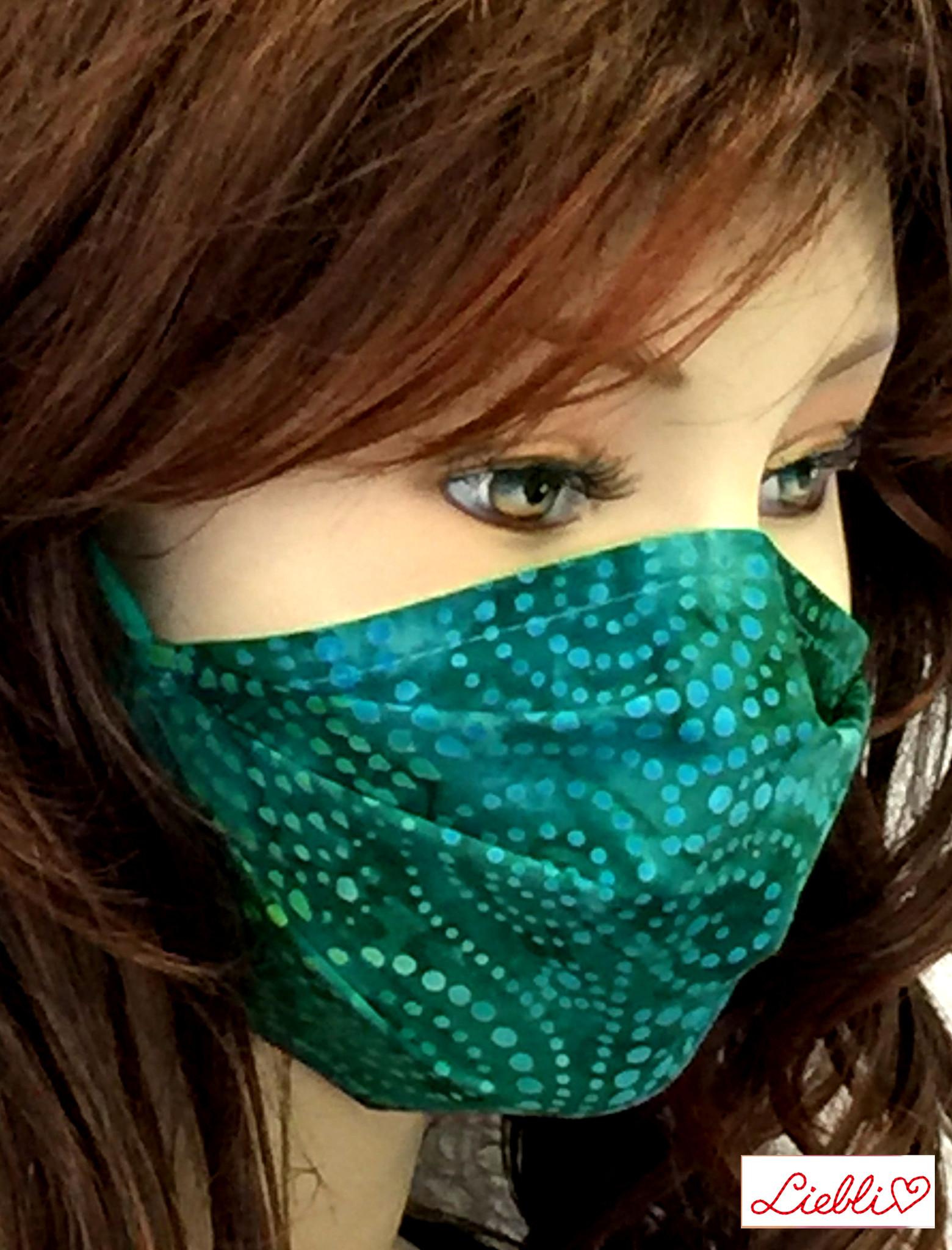 Schöne Stoffmasken/ modische, elegante Masken,  Stoffmaske Spirale blaugrün