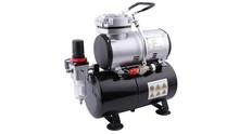 Airbrush mini compressor with air reservoir