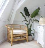 Beautiful rattan braided armchair with cushion