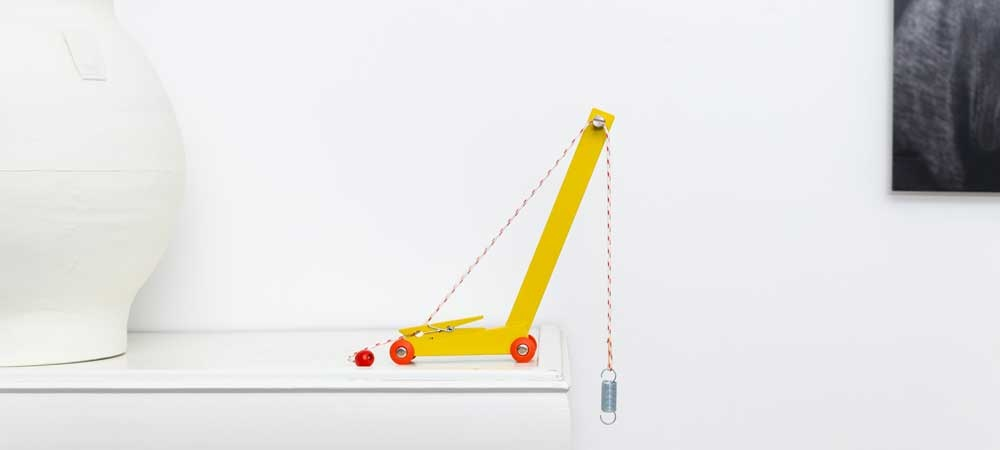 Handmade Yellow Toy Crane by Floris Hovers
